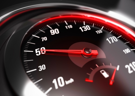 Close up of a car speedometer with the needle pointing 50 Km h, blur effect, conceptual image for safe driving concept