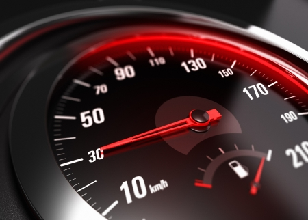 Close up of a car speedometer with the needle pointing 30 Km h, blur effect, conceptual image for safe driving concept
