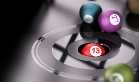 Gambling concept, chance and number thirteen  One ball with the number 13 inside a hole with other balls around it  Conceptual 3D render image