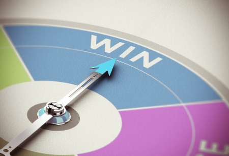 Winning concept. Compass needle pointing the word win over paper background with blur effect