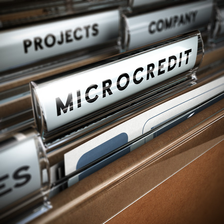Folder with focus on a tab and the word microcredit, blur effect  Concept of company projects funding