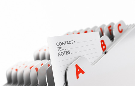 Customer file organized alphabetically with focus on a contact note, white background. Conceptual business image for illustration of clients base, or prospect list.