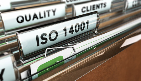 Close up on a file tab with the word ISO 14001, focus on the main text and blur effect. Concept image for illustration of Quality Standards