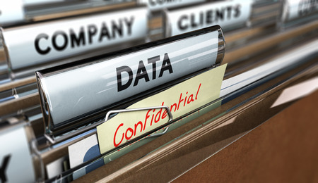 Close up on a file tab with the word data and confidential, focus on the main text and blur effect. Concept image for illustration of company data protection.