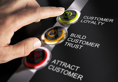 Foto de Finger about to press customer loyalty button. Concept for illustration of sales process. - Imagen libre de derechos