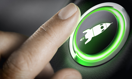 Foto de Man finger pressing an boost button with a rocket icon, black background and green light. Composite between a photography and a 3D background. Start-up concept.  - Imagen libre de derechos