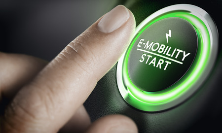 Man pushing green car button. Concept of e-mobility. Composite image between a hand photography and a 3D background.