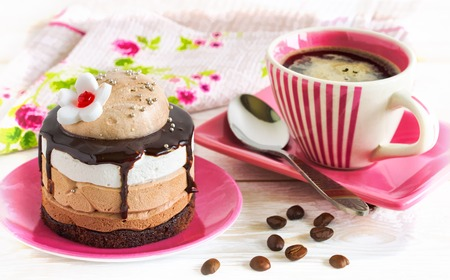 Gourmet coffee. Cup of coffee and cake