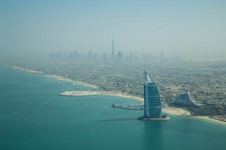 Dubai, United Arab Emirates - October 17, 2014: Photograph of the famous Burj Al Arab hotel in Dubai taken from a seaplane.