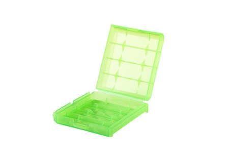 Foto de Plastic green battery boxes for storage isolated on white background - Imagen libre de derechos