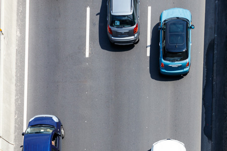 Top view of cars moving on highway