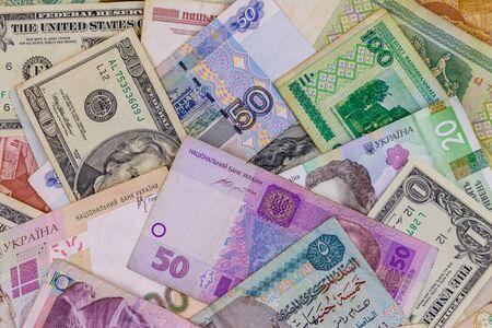 Photo pour Multicurrency background of US dollars, Russian rubles, Belarusian rubles, Egyptian pounds and Ukrainian hryvnias - image libre de droit