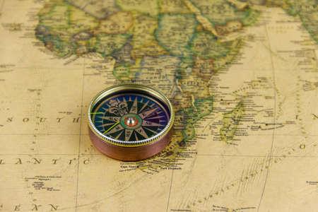 Foto de Compass on a vintage world map. Retro style - Imagen libre de derechos