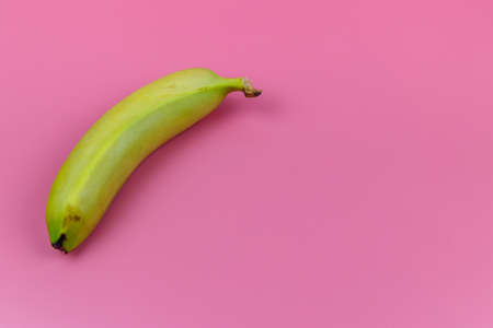 Photo pour Yellow banana on pink background. Top view, flat lay, minimal design - image libre de droit