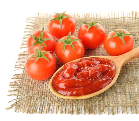 Tomato sauce and ripe tomatoes on white background