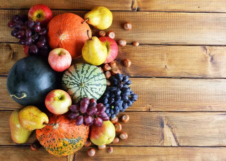 Photo for Autumn fruit on a wooden background - Royalty Free Image