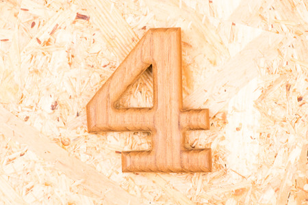 wooden numbers 4 on recycle wood background