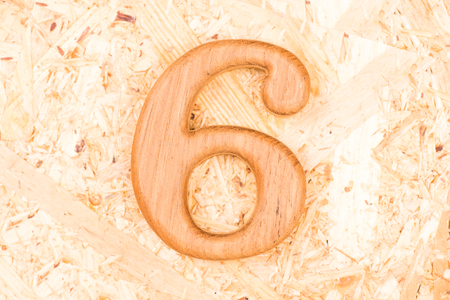 wooden numbers 6 on recycle wood background