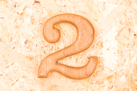 wooden numbers 2 on recycle wood background