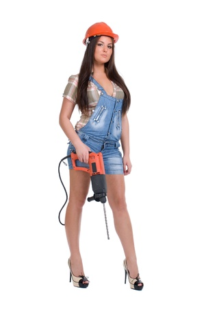 Young woman in orange helmet holding hammer drill