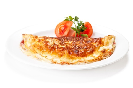 Omelet with herbs and tomatoes isolated on white