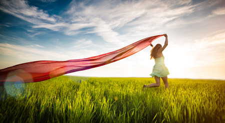Photo pour Young lady runing with tissue in green field. Beautiful happy woman walking in the summer rural meadow. Beautiful fit tan girl. Sexy slim model caucasian ethnicity outdoors. - image libre de droit