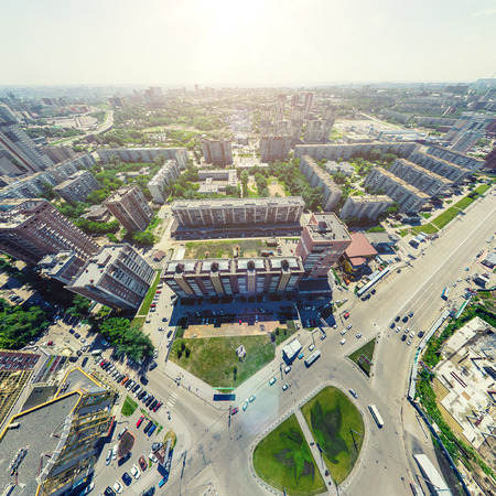 Aerial city view. Urban landscape. Copter shot. Panoramic image.