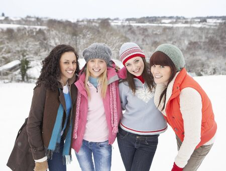 Group Of Female Friends Having Fun In Snowy Landscape