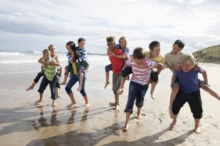 Teenagers playing piggyback