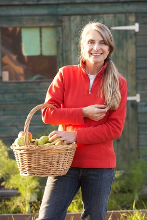 Woman with home-grown fruit