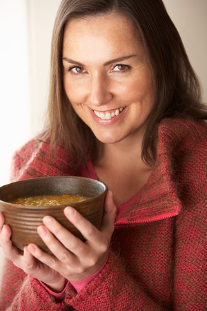 Woman holding bowl of soup
