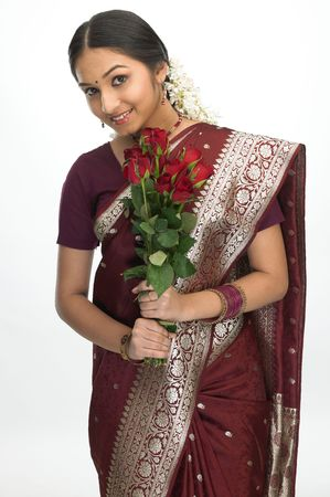 Attractive indian girl with bunch of red rosesの写真素材