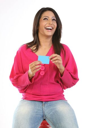 Smiling woman with  blue blank  card
