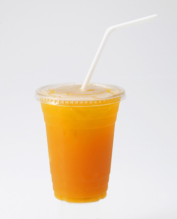 Photo pour Orange Juice in cup with straw on white background - image libre de droit