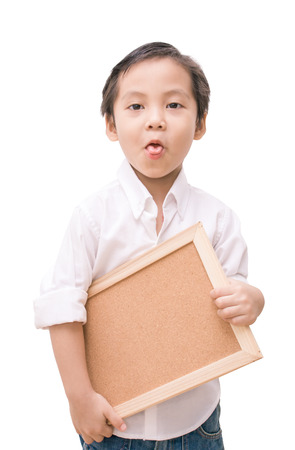 portrait of a little boy holding a board over white background