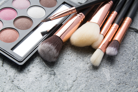 various makeup products on dark stone backgroundの写真素材