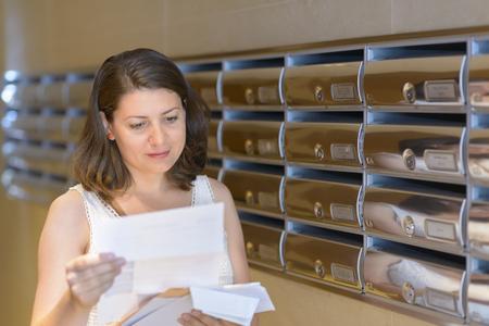 Beautiful woman reading correspondence
