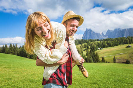 Photo for Beautiful young couple traveling in the Dolomites, Italy - Two lovers having a day trip in the nature - Royalty Free Image