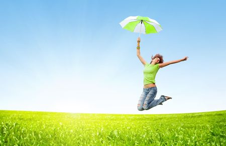Photo pour young girl jumping with umbrellas - image libre de droit