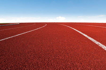 Athletics Stadium Running track curve and blue sky
