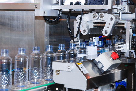 Bottling water on the process in factory