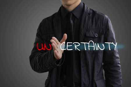 The concept of certainty. Businessman making certainty from unce