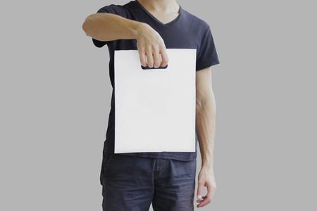 Man shows blank plastic bag mock up isolated. Empty white polyethylene package mockup.