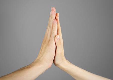 Photo pour Women's men's palm touches palm. High five. Isolated. - image libre de droit