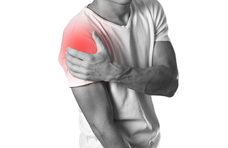 Foto de A man holding hands. Shoulder pain. The hearth is highlighted in red. Close up. Isolated on white background. - Imagen libre de derechos