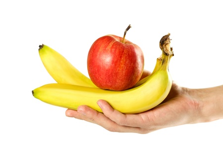 Photo for Hand holding bananas and red apple. Close up. Isolated on white background. - Royalty Free Image