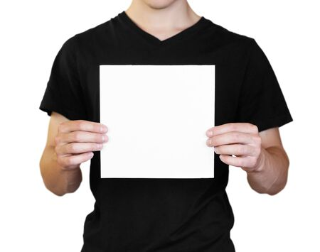 Photo pour A man holding a white sheet of paper. Holding a booklet. Close up. Isolated on white background. - image libre de droit