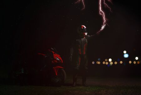 Photo pour The rider in the gear and the helmet touches the flash of lightning. - image libre de droit