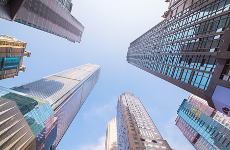 Foto per Looking up at business buildings in downtown New York, USA - Immagine Royalty Free