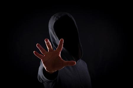 Photo pour Men in hoodies in black background - image libre de droit